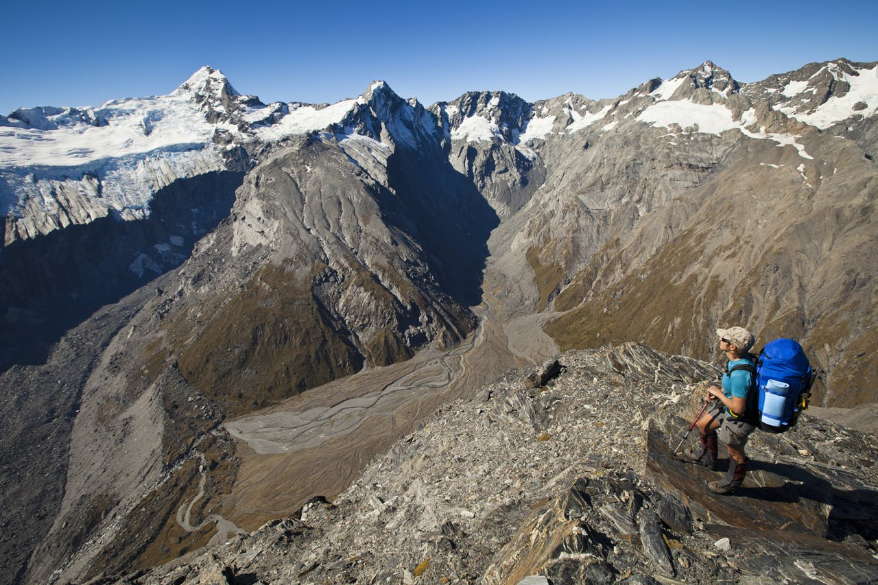 On the summit of The Gladiator (2125m) an incredible panorama opens. From left: Sierra Range and Douglas Neve; Mount Sefton; Mount Thomson, Eagle Peak, Maunga Ma and Mount Isabel. Harper's Rock Bivouac is the black triangular boulder by the dry streambed at bottom left. Photo: Mark Watson