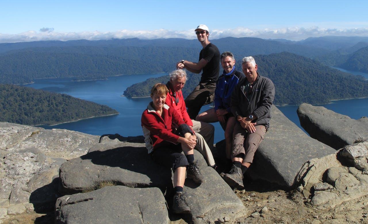 Taking a break on the guided Lake Waikaremoana trip. Photo: Walking Legends