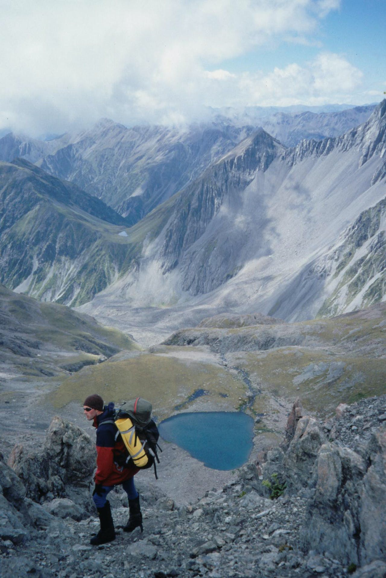 Surveying Taruahana Pass and Tarn Col from the ridge above Lake Mavis. Photo: Richard Davies