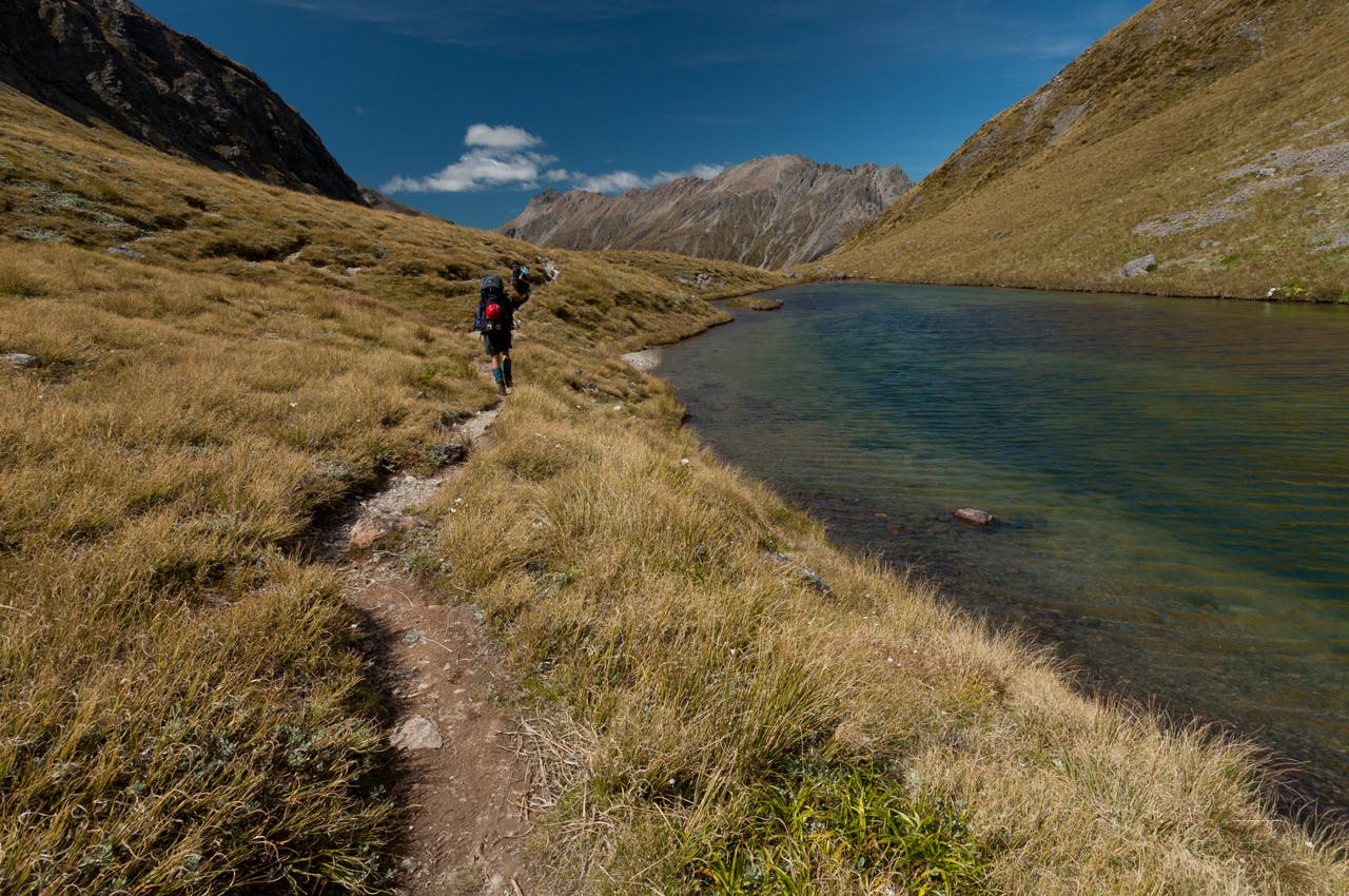 Crossing the main divide at the side of Tarn Col. Photo: Fraser Crichton