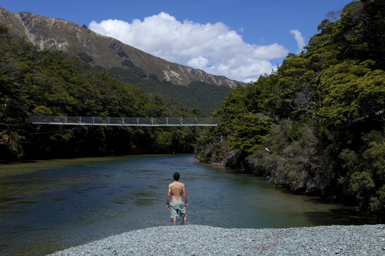 Dallas Hewett takes a dip at the outlet of the North Mavora Lake. Photo: Derek Morrison