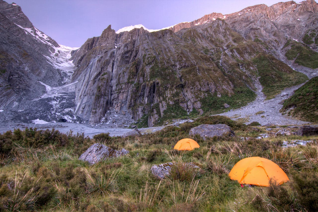 Camping beneath rivers of ice in the Upper Otoko Valley. Photo: Troy Mattingley