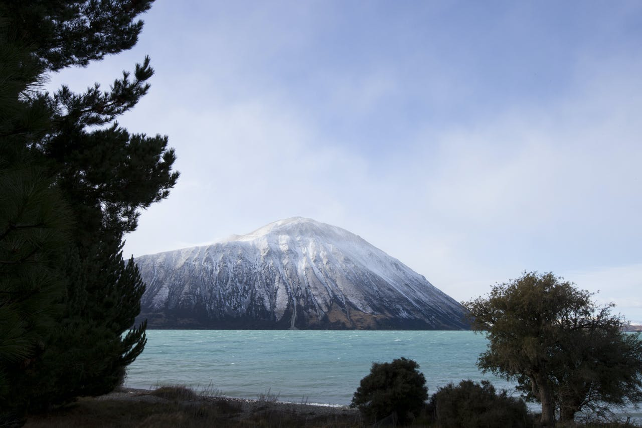 Snow storm rolls in over mountains above Lake Ohau, South Canterbury, New Zealand. Photo: www.derekmorrison.co.nz