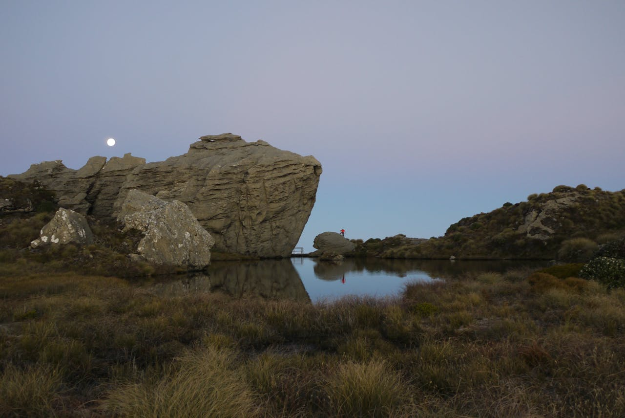A full moon rises above the large tarn and rock features on the Hump Ridge. Photo: Alistair Hall