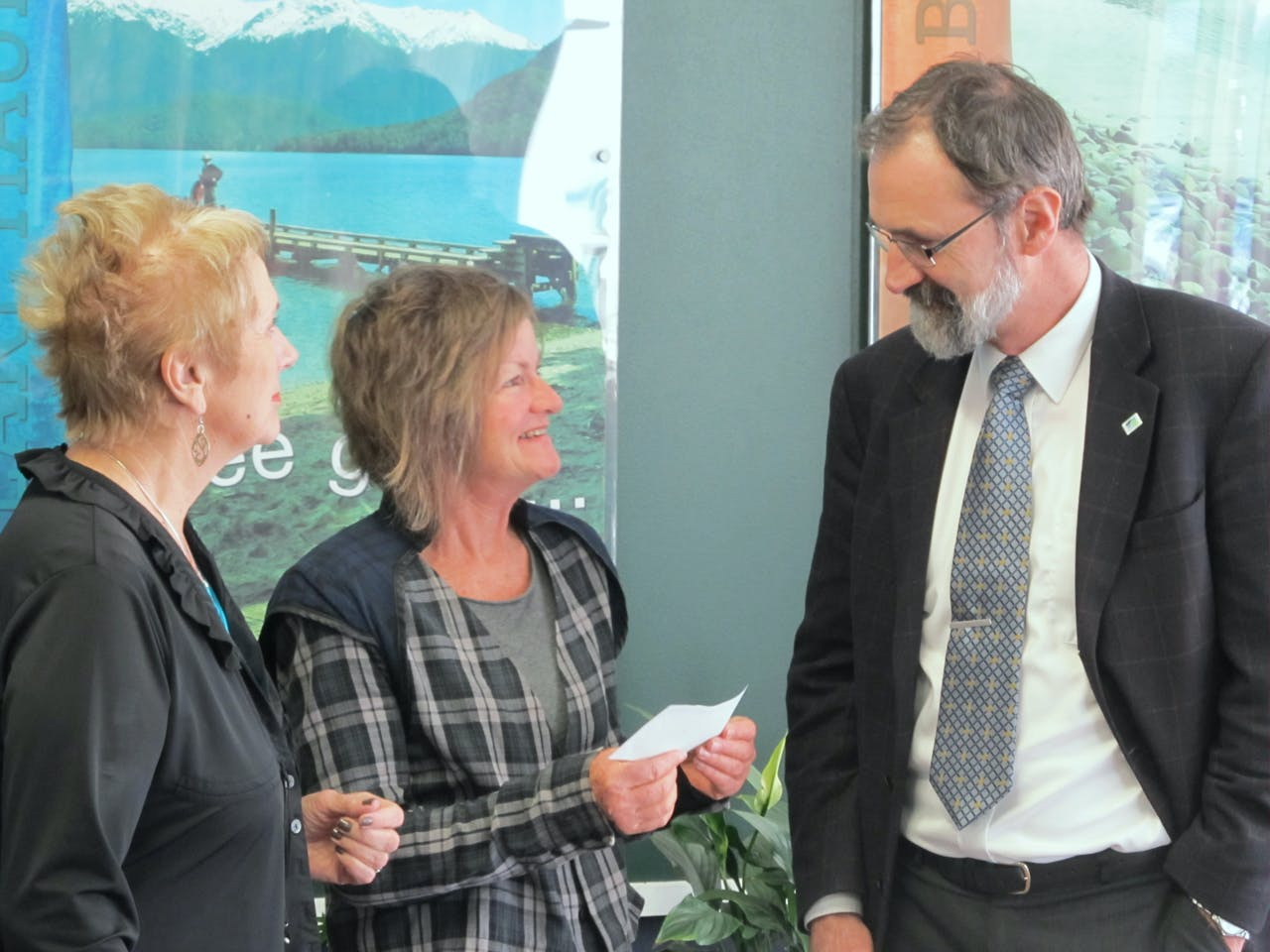 FMC's Robin McNeil hands over a cheque for $1000 to Southland District Council Mayor Frana Cardno (left) and Save Fiordland Chairperson Daphne Taylor