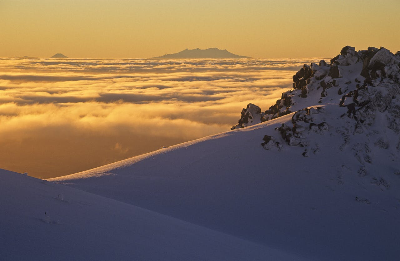 Sunrise over Mt Ngauruhoe and Mt Ruapehu from Taranaki's Fantham's Peak. Photo: Shaun Barnett