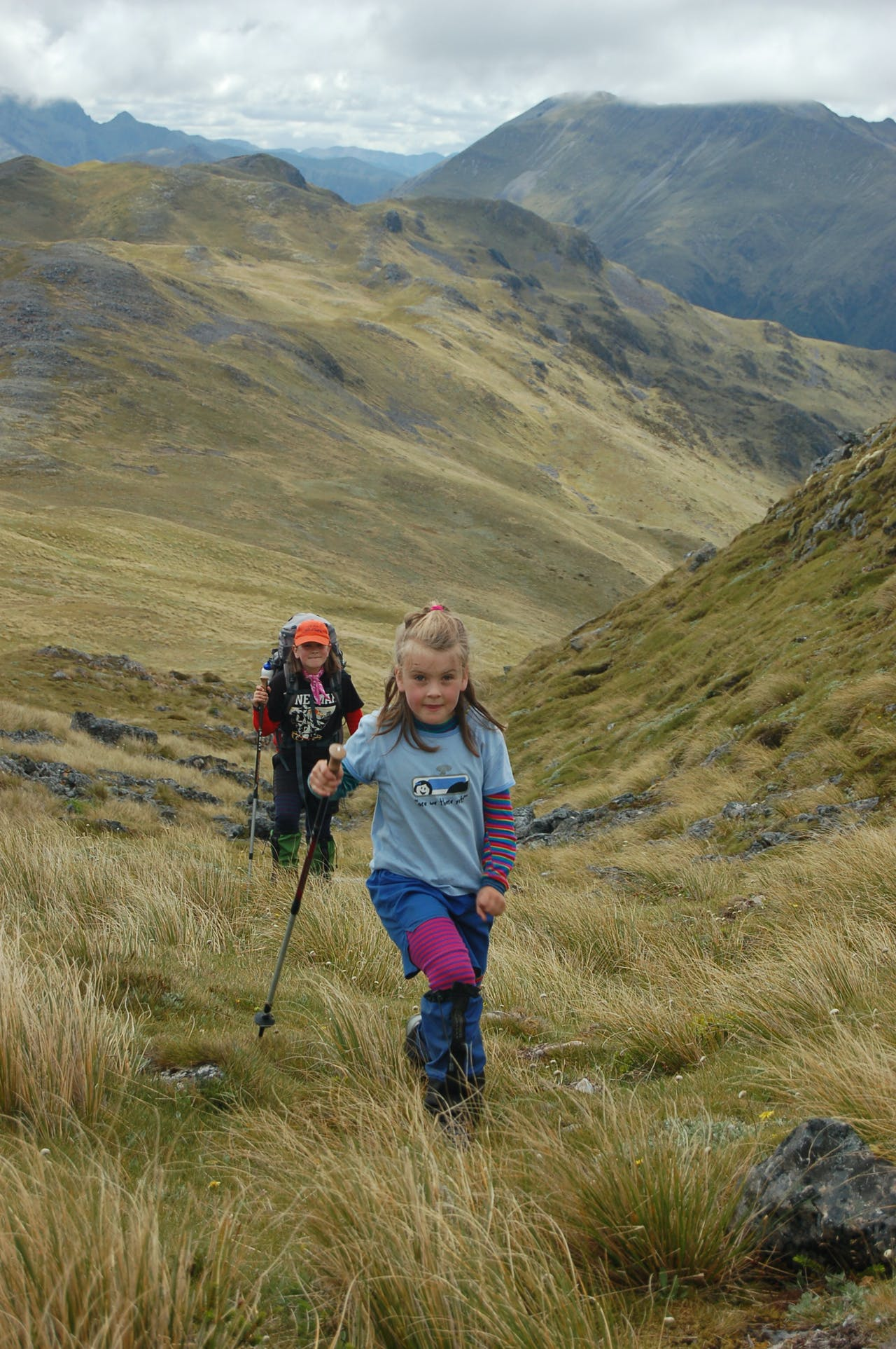 Mackenzie (in foreground) and Alice approach a low saddle on the ridge. Photo: Jo Stilwell