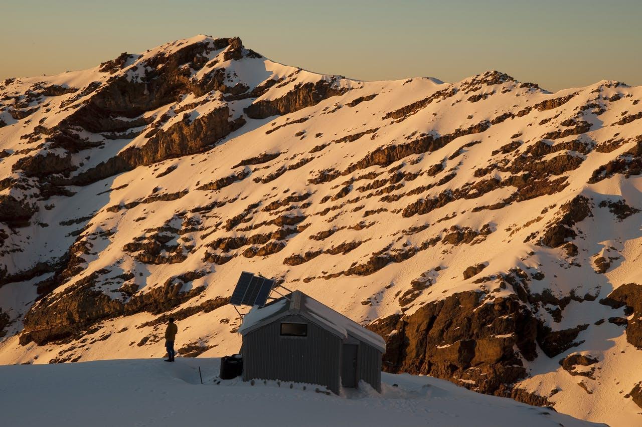 Sunrise on Whangaehu Hut and valley, Mt Ruapehu, Tonagriro National Park. Photo: Shaun Barnett