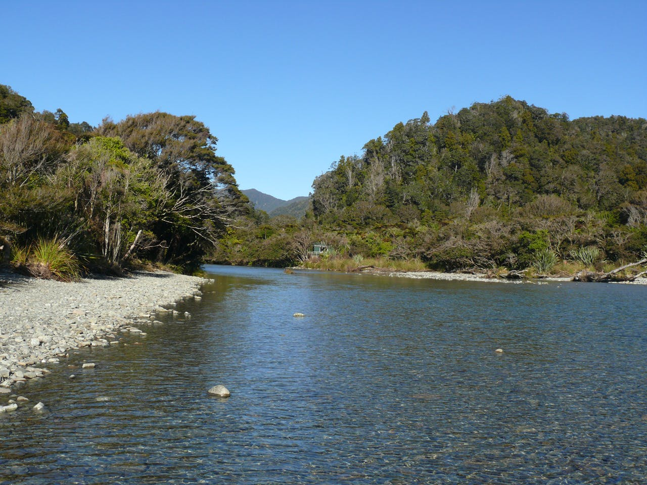 The mouth of the Stafford River with Stafford Hut nestled on its banks. Photo: Geoff Spearpoint