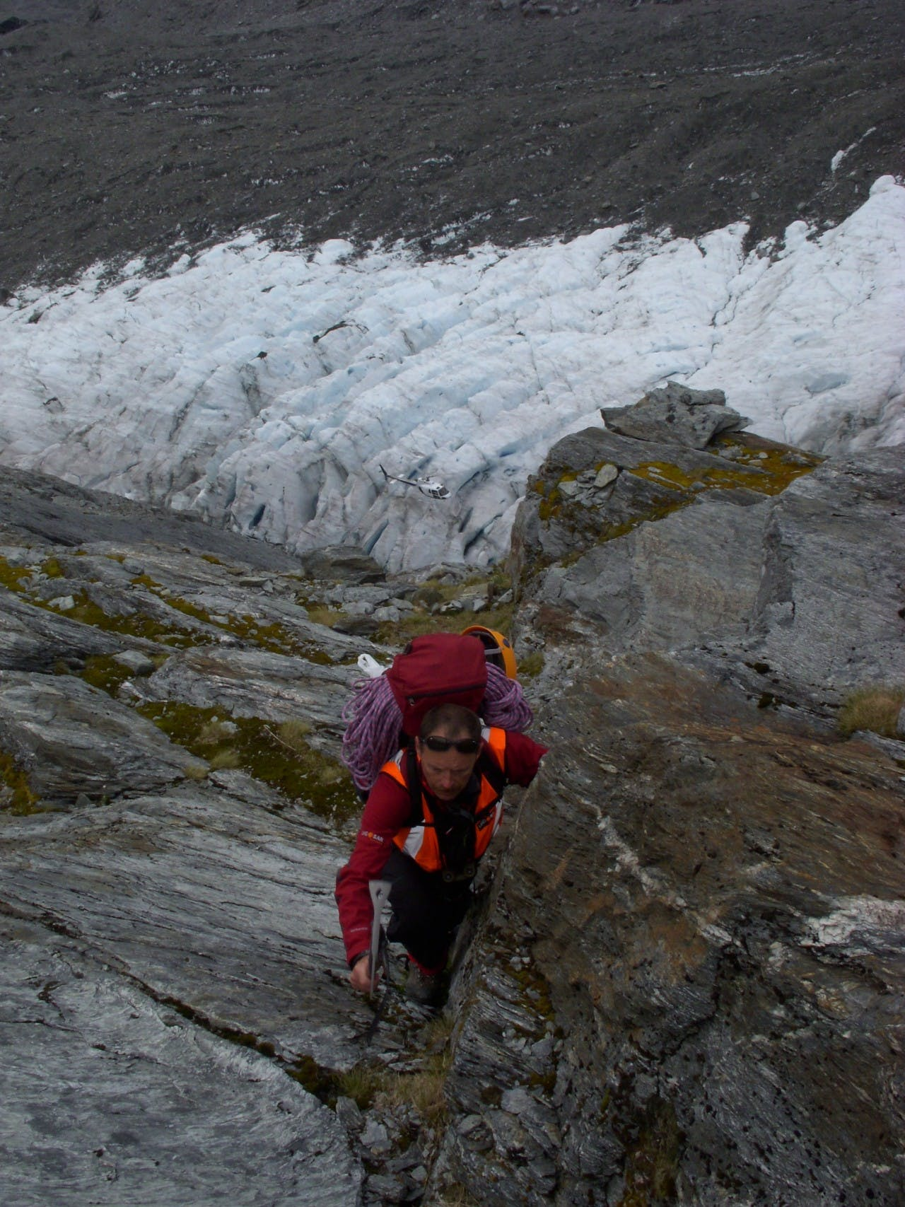 A SAR volunteer climbs above the Dart Glacier on a training exercise