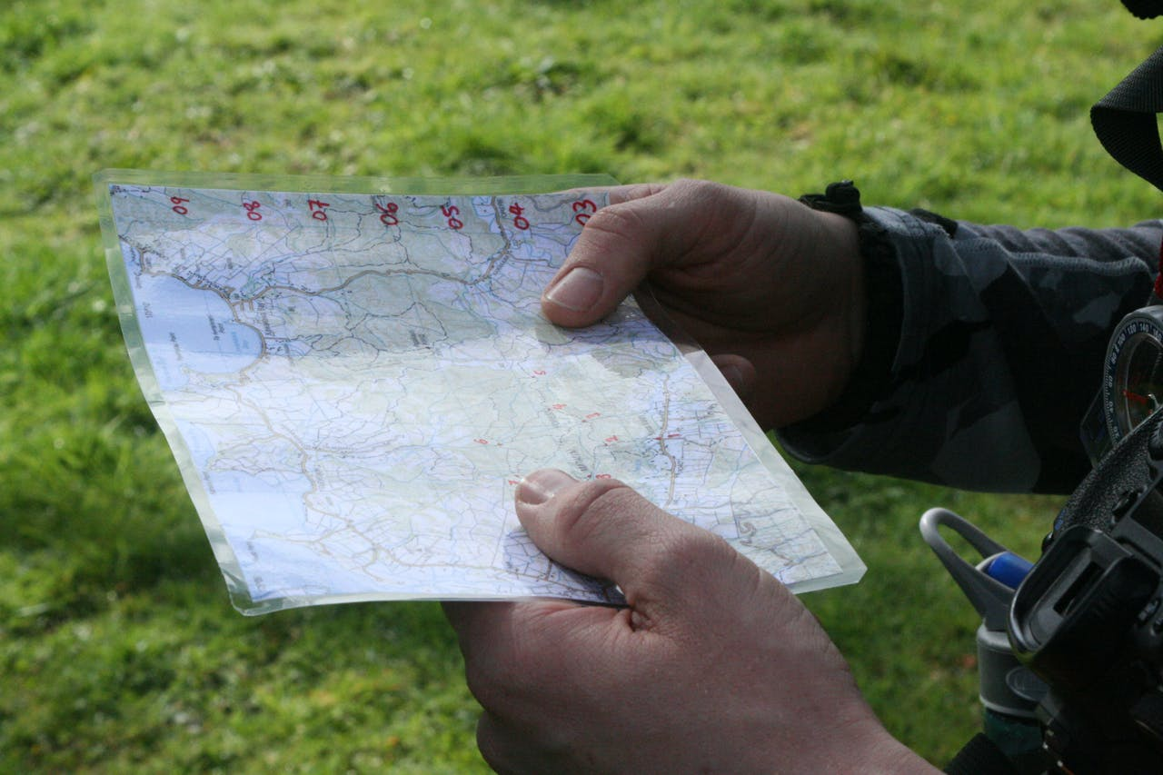 Small pre-prepared maps of the area you're traveling in are easier to handle than full topos. Photo: Josh Gale