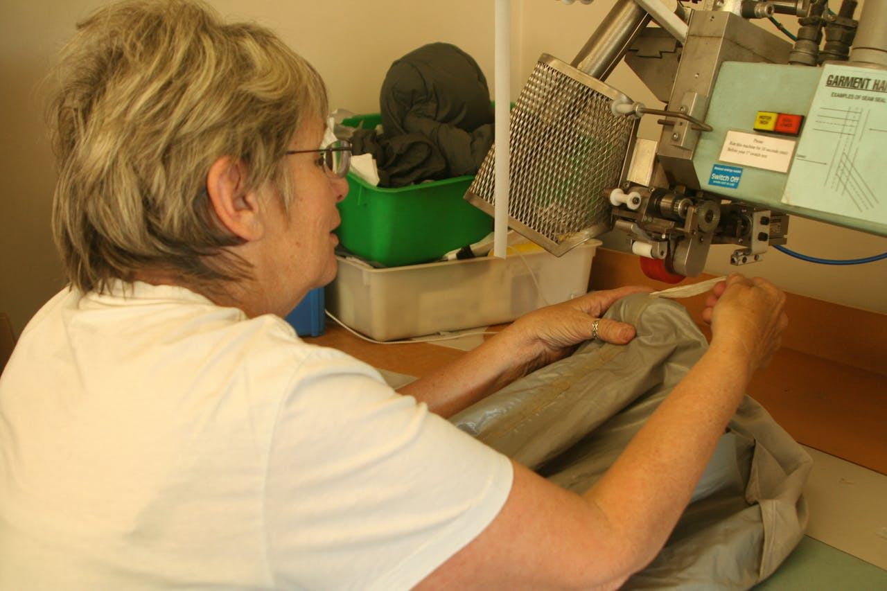 Learning how to use the seam sealer is a must for Macpac's design staff, who also apply a water pressure test to garments to check if they are waterproof