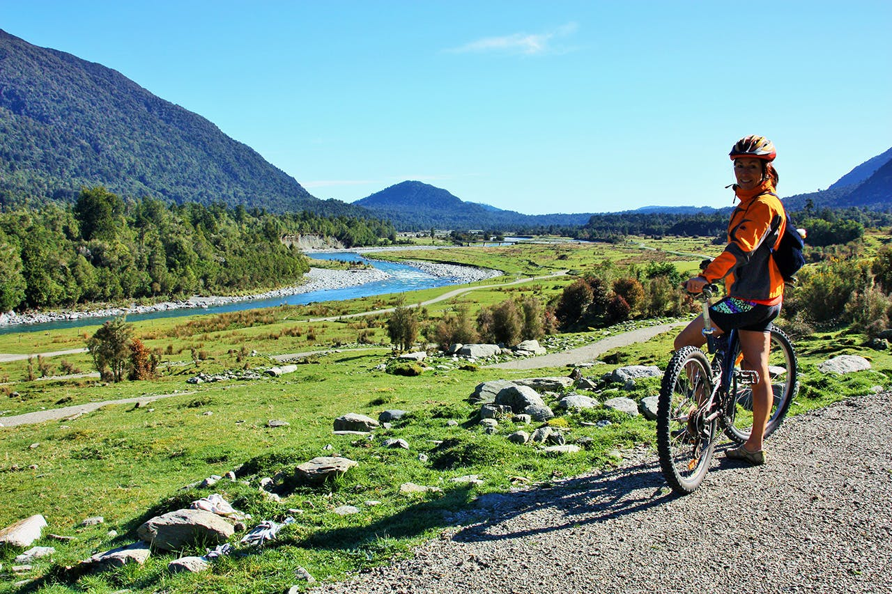 Admiring the Arahura Valley on the West Coast Wilderness Trail. Photo: Wilderness Trail Shuttle