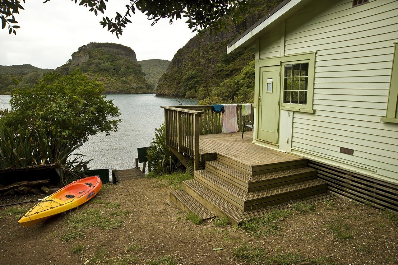 Lane Cove Hut overlooks Whangaroa Harbour. Photo: Shaun Barnett/Black Robin Photography
