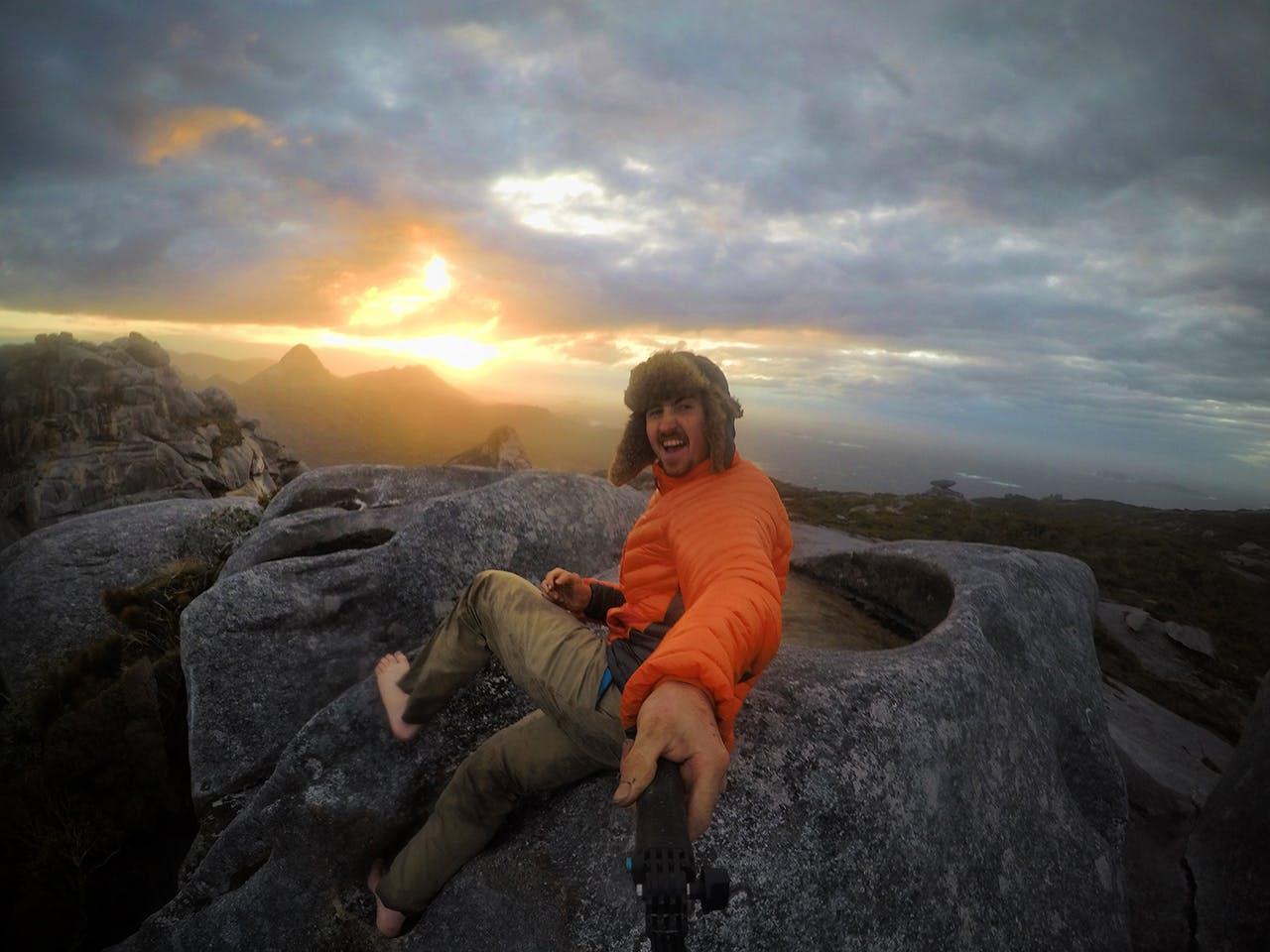 Brando atop Magog during his 30-day tramp around Stewart Island. Photo: Brando Yelavich