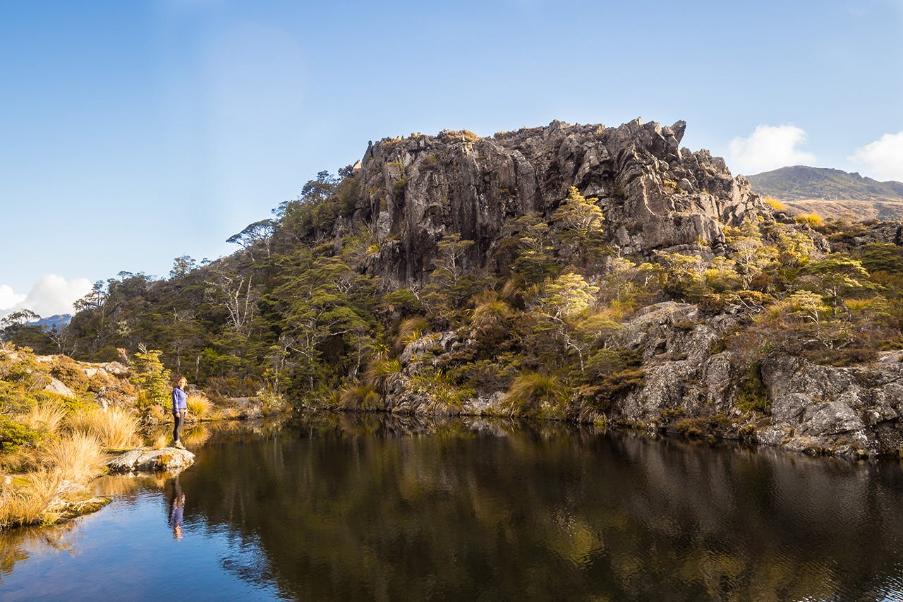 Fenella Hut's charms include this gorgeous tarn. Photo: Jack Houghton
