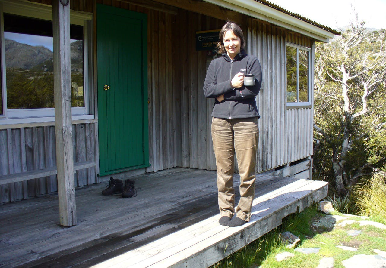 The author sips tea at Fenella Hut – her first tramp in 35 years. Photo: David Dewes.