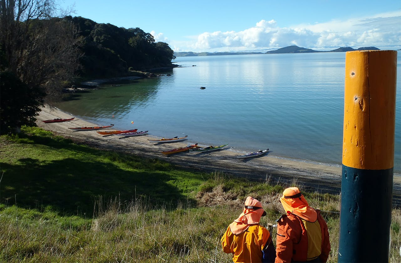 Kayaks on the beach, ready for the next section of Te Ara Moana. Photo: Ruth Henderson