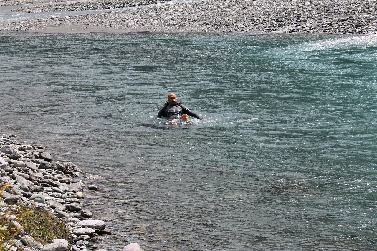 When knocked off your feet, lean into your pack and point your feet downstream. Photo: Carrie Miller