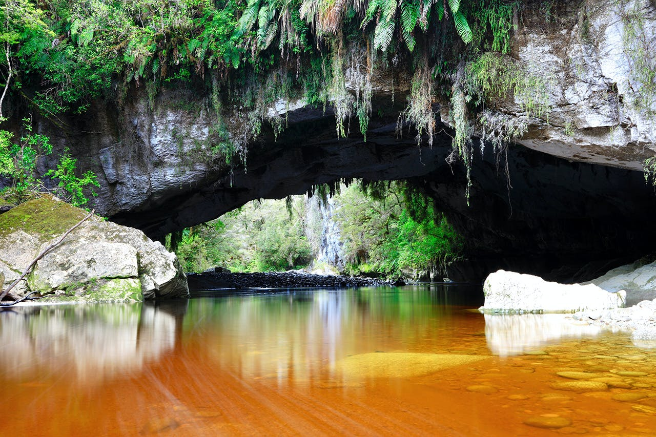 Oparara Arch has been sculpted by the Oparara River. Photo: Richard Rossiter